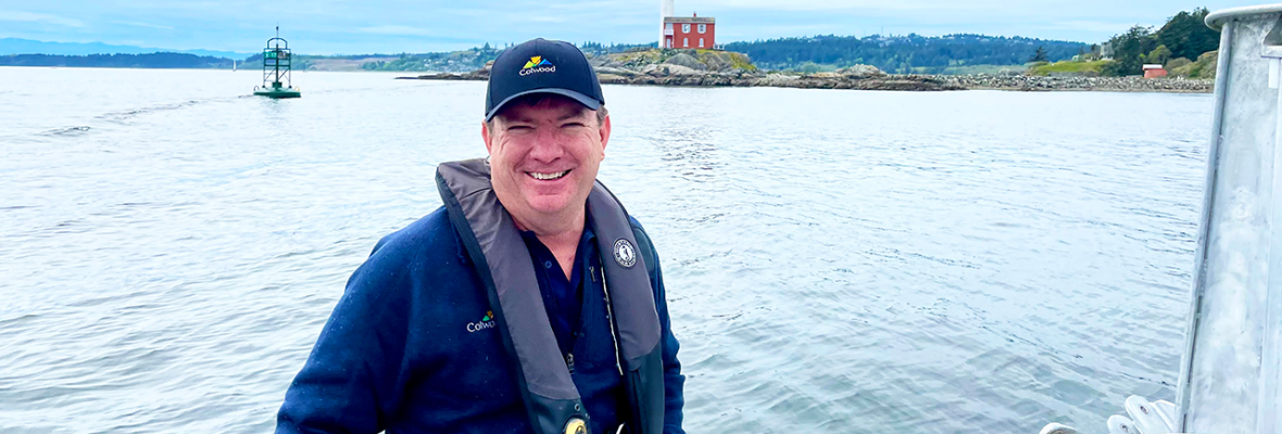 mayor on boat by lighthouse
