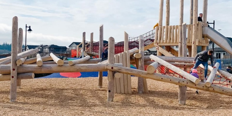 playground with timber play structures at meadow park green in royal bay