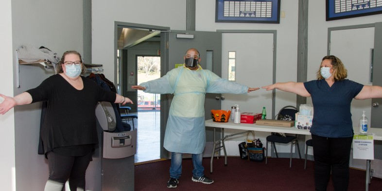 flu clinic staff masked and distanced