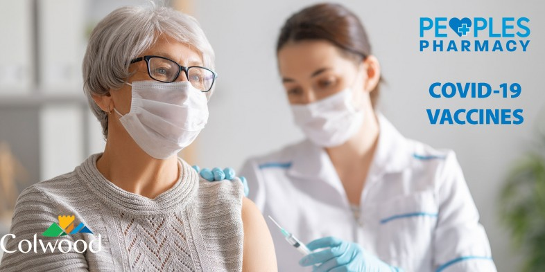 woman receiving vaccine from pharmacist