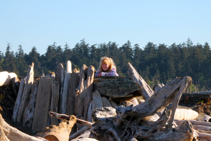 girl in driftwood fort on the Colwood waterfront