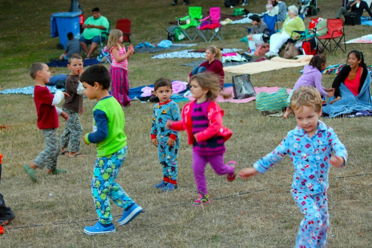 Kids dancing in pajamas at Movies on the Hill at West Shore Parks & Recreation